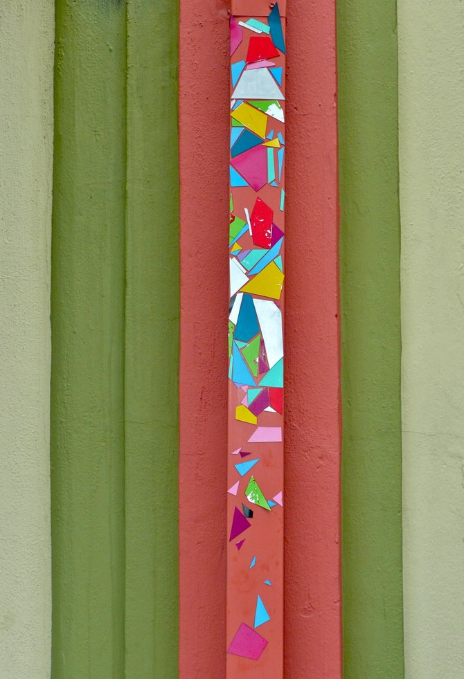 Magnetic Art makes even rain downspouts artistic on Ray St.,
