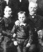 "Hannah and Miles Romney with their son Leo, in Mexico around 1891. Hannah: ""If anything will make a woman's heart ache, it is for her husband to take another wife."""