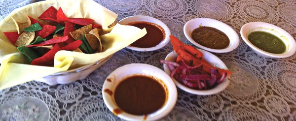 The salsa bar offers two reds (one spicy, the other less so but with more smoke), an earthy, bright-green tomatillo and jalapeño, and a pineapple-based salsa with a hint of sweetness.