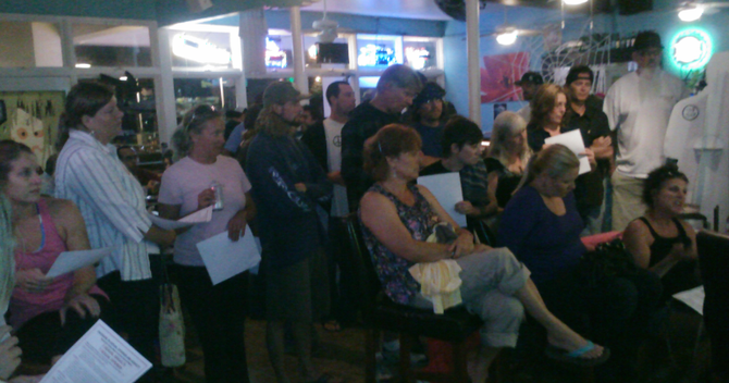 A rapt crowd listened to the victim tell her story at Tower Two Café.