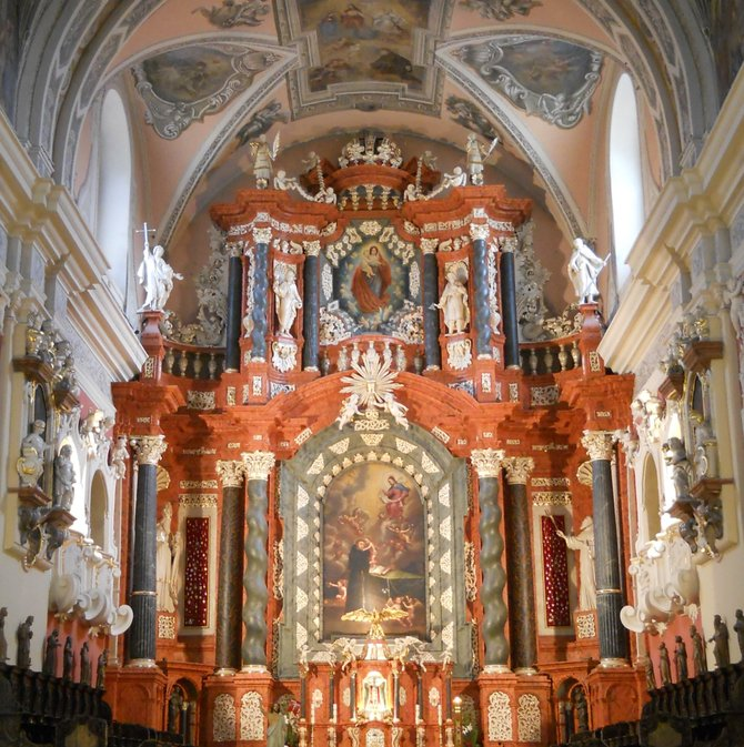 The Franciscan Church High Altar in Poznan (c1690). There are two paintings in the St. Anthony of Padua Church on Castle Hill: Vision of St. Anthony and the Blessed Virgin Mary Immaculately Conceived (1877) at the top of the altarpiece. In the presbytery and the nave (barrel vault with lunettes), the basilica has the Franciscan monk Adam Swach work completed in around 1702: polychrome painting depicting scenes from the St. Anthony life.