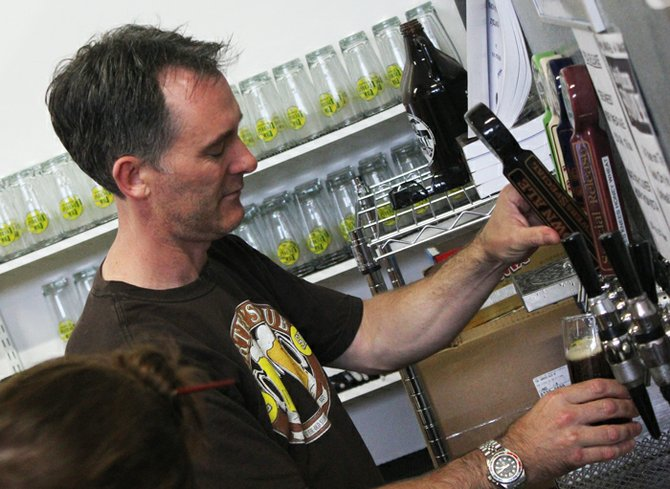 New English owner and brewer Simon Lacey pours a proper pint at his Sorrento Valley tasting bar.