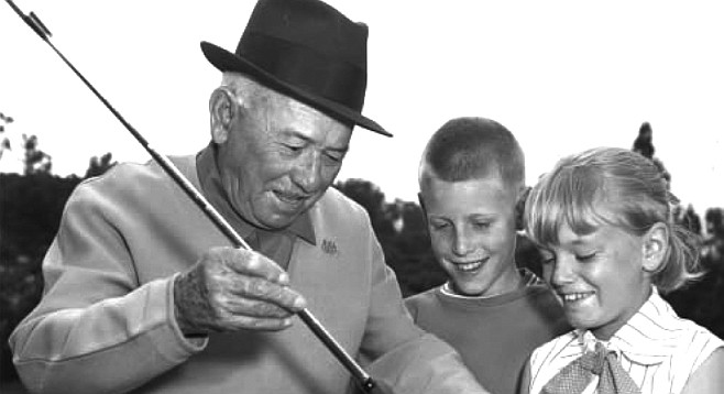 Al Abrego helping young golfers with their grip.