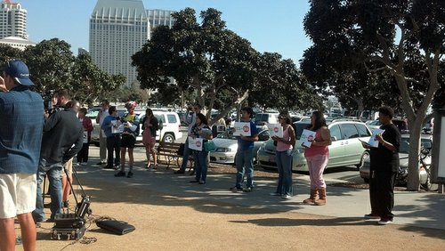 The gathering drew nearly as many Prop 30 backers as opponents