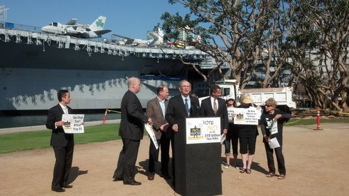 San Diego Tax Fighters' Richard Rider at the podium, with San Diego County Republican Party chair Tony Krvaric, Howard Jarvis Taxpayers Association's Jon Coupal, and other Prop 30 opponents