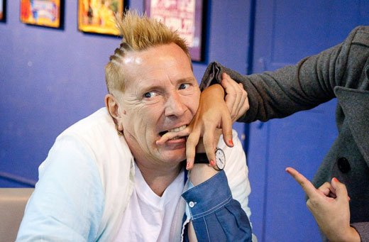 John Lydon biting a fan's hand at Ameoba Records in San Francisco.