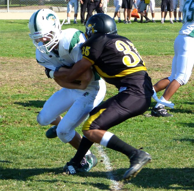 Mission Bay linebacker Jhamir Ransom wraps up a Coronado runner