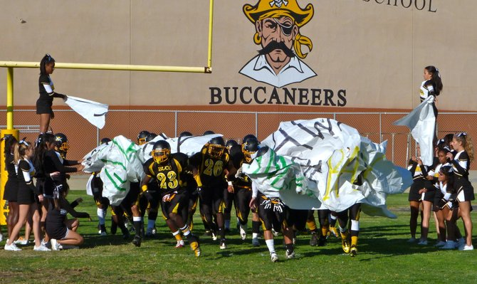 Mission Bay players break through the banner after halftime