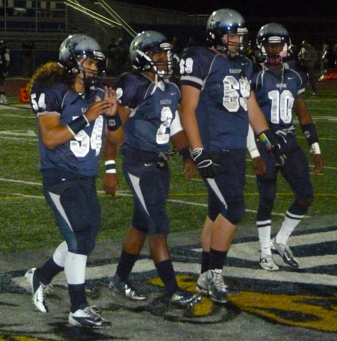Madison senior captains (left to right) Keoni Kanoa, Pierre Cormier, Devin Tomlinson and Lee Walker walk to midfield for the coin toss