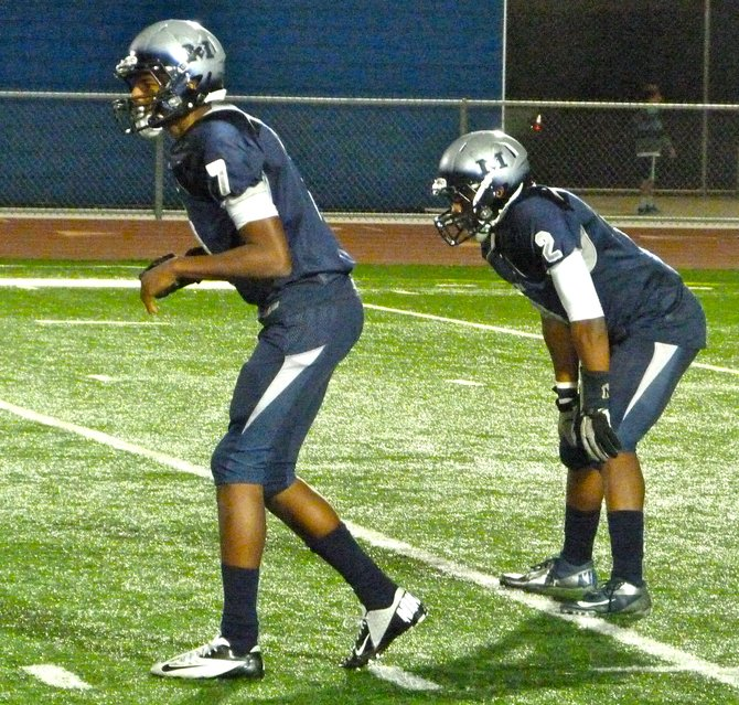 Madison sophomore quarterback Kareem Coles (left) and senior running back Pierre Cormier in the backfield