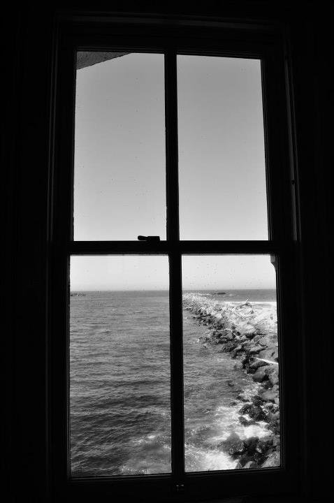 Veiw through a window of a lighthouse on the California Coast