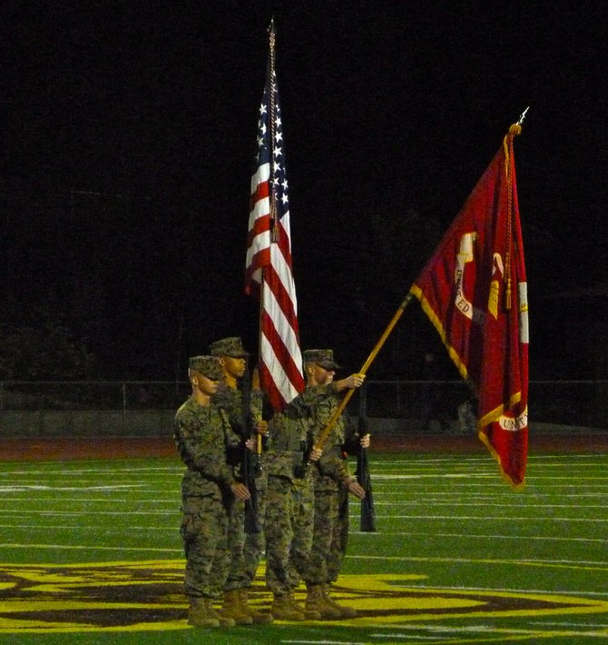 Members of El Camino High's Marine Corps JROTC Program present the flag for the national anthem