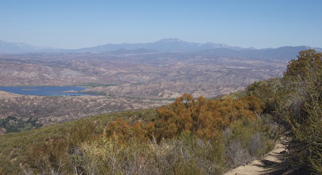 Dripping Springs Trail features this northward view of Vail Lake in the foreground and the San Jacinto mountains in the distance.