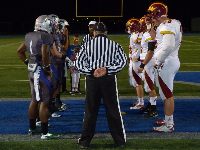 Eastlake and Torrey Pines captains meet at midfield for the coin toss