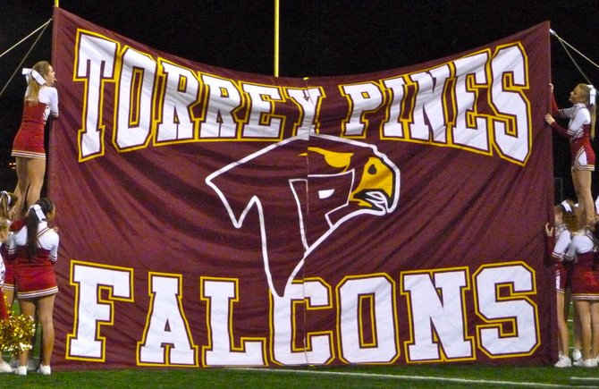 Torrey Pines cheerleaders hoist the Falcons banner at halftime