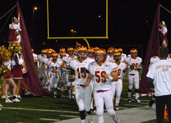 Torrey Pines players break through the banner and take the field for the second half