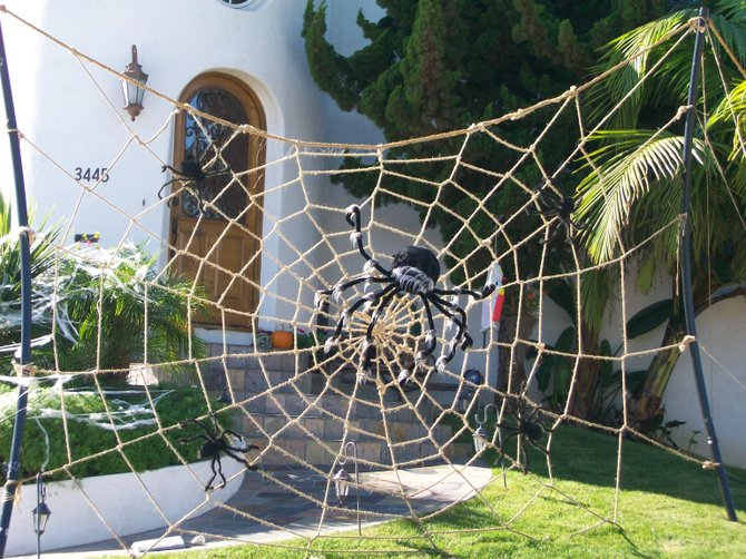 Giant Halloween spider web at house on Elliott St. in Point Loma.