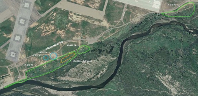 Circled areas near the border indicate cleanup sites