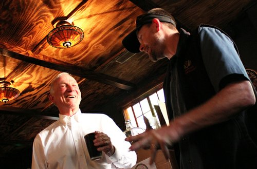 San Diego Brewers Guild president Shawn DeWitt of Coronado Brewing Company shares a laugh with Jerry Sanders