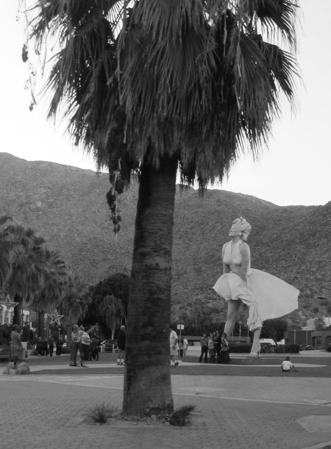 Visitors to Palm Springs admire the new Marilyn Monroe statue