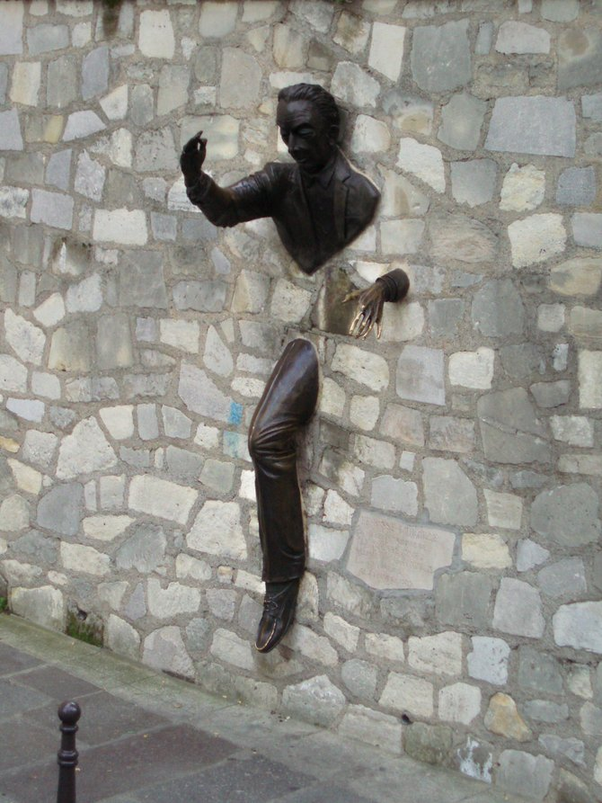 Could that be Salvador Dali stepping out of the wall? Montmartre, Paris, France