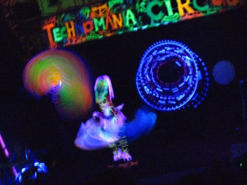 Blacklight Illusion Act image. Technomania Circus