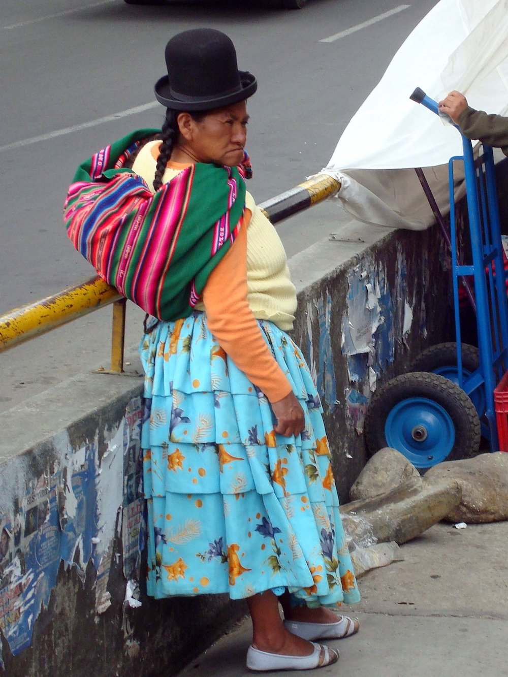 Bolivian woman with the traditional aguayo.