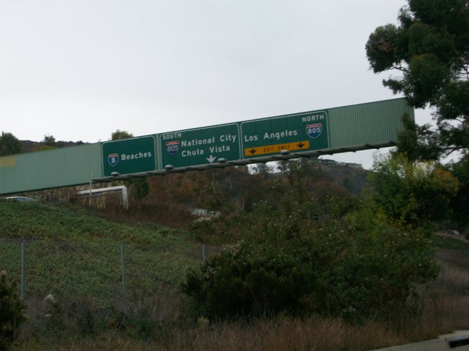 Freeway signs along Interstate 8 West in Mission Valley.