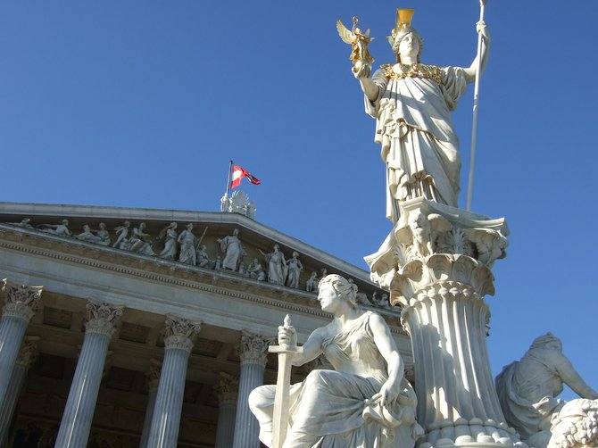 Athena keeps watch outside the city's majestic Austrian Parliament Building.
