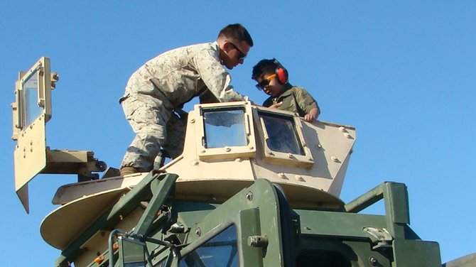 we went to the  miramar airshow 2012.it's my sons first time riding in a real tank with the soldier next to him.one of my sons always want to experience.he's very happy that time :)