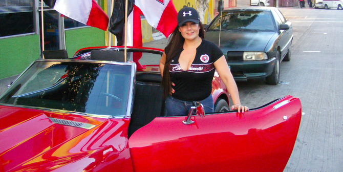Xolos fan and her red '72 Corvette