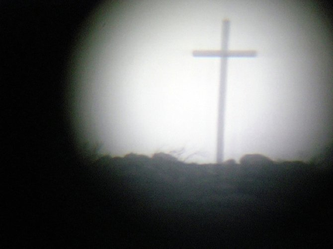 The cross on the mountain in Rancho Bernardo as seen through the telescope in my dining room.