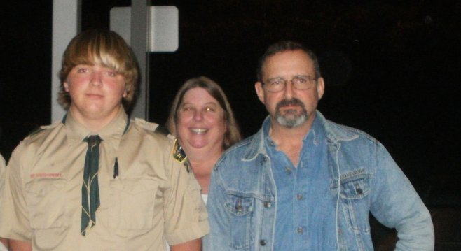 Kyle Armstrong and his parents