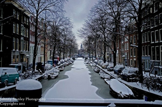 A Frozen Snowy Canal In Amsterdam