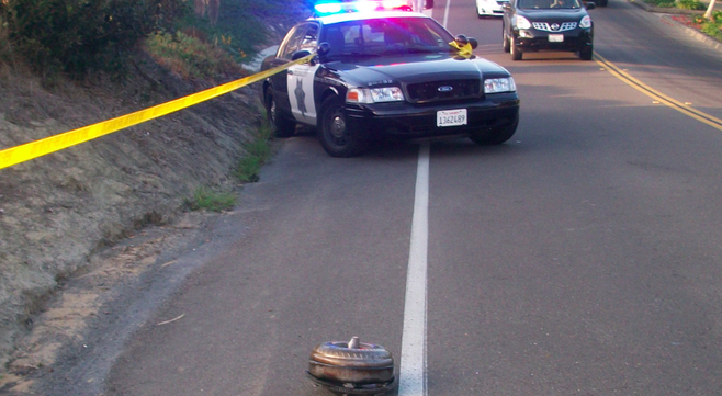 A piece of the tow truck's transmission landed on San Elijo Avenue, 200 yards from the accident.