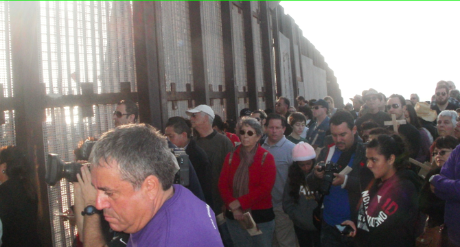 Border Patrol agents opened the gate to let hundreds of people stand with dozens more on the Mexico side of the fence.