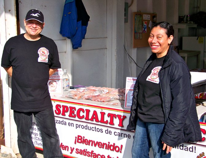 Señor Salchicha, and his wife, Luci, happily display their premium meat products for visitors at a recent Ensenada area food fair.
