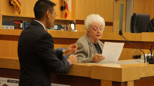 Prosecutor Keith Watanabe with Mrs. Lina Harper.  Photo Weatherston.