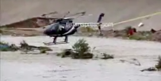 A helicopter finally rescued the couple from the middle of the canal (image from Tijuana Press video)