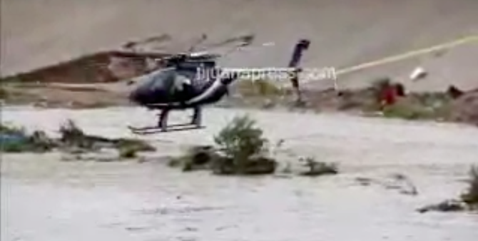A helicopter finally rescued the couple from the middle of the canal (image from Tijuana Press video
