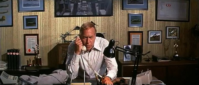 A typical example of director Jack Smight's compositional tension at its tensest. George Kennedy is surrounded by enough side-room to park both sequels.