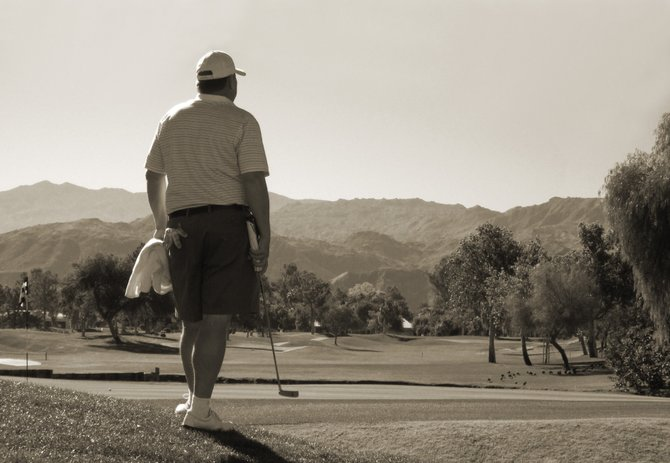 Considering his next shot, a golfer in Rancho Mirage