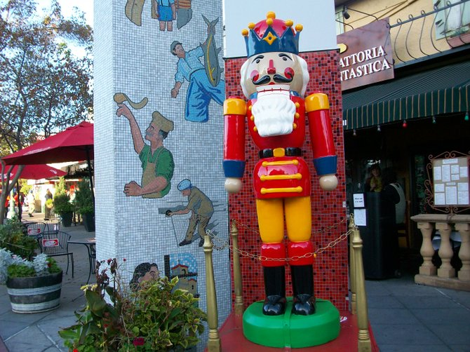 Colorful Christmas Nutcracker in front of Reader offices in Little Italy.