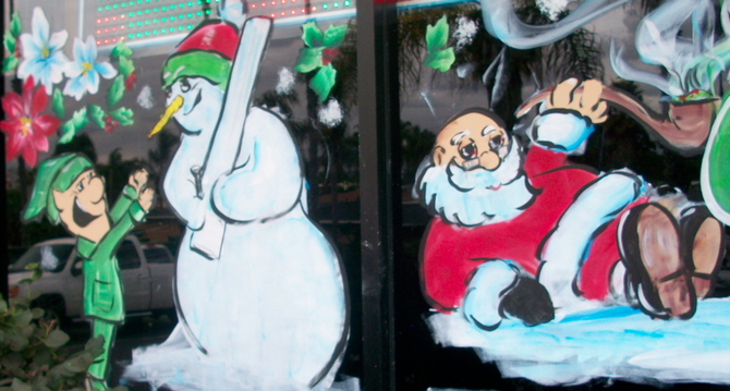 Santa and Frosty on Outer Limits Smoke Shop's window