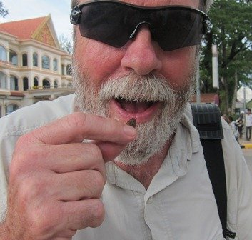 The author snacking on moth larvae.