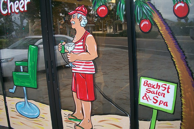 Santa after a shave (with a cocktail) at Carlsbad's Beach Street Salon and Spa