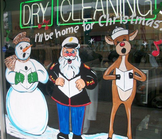 Kingsman Cleaners in downtown Oceanside has Santa in his Marine dress blues.
