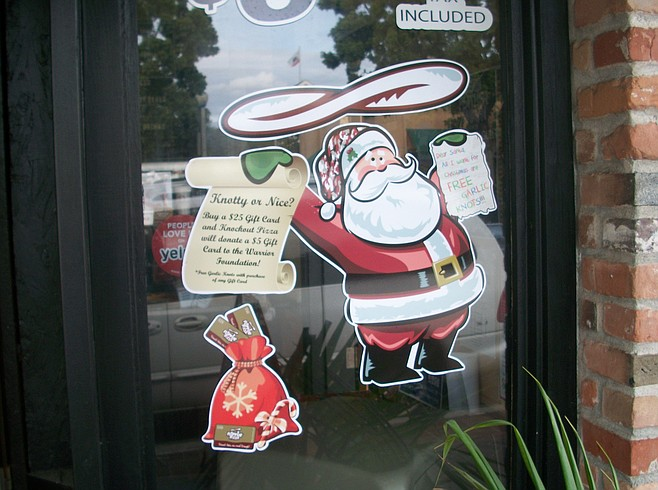 Santa flips pizza dough at Knockout Pizza, located on Carlsbad Boulevard (Carlsbad's name for Coast Hwy.)
