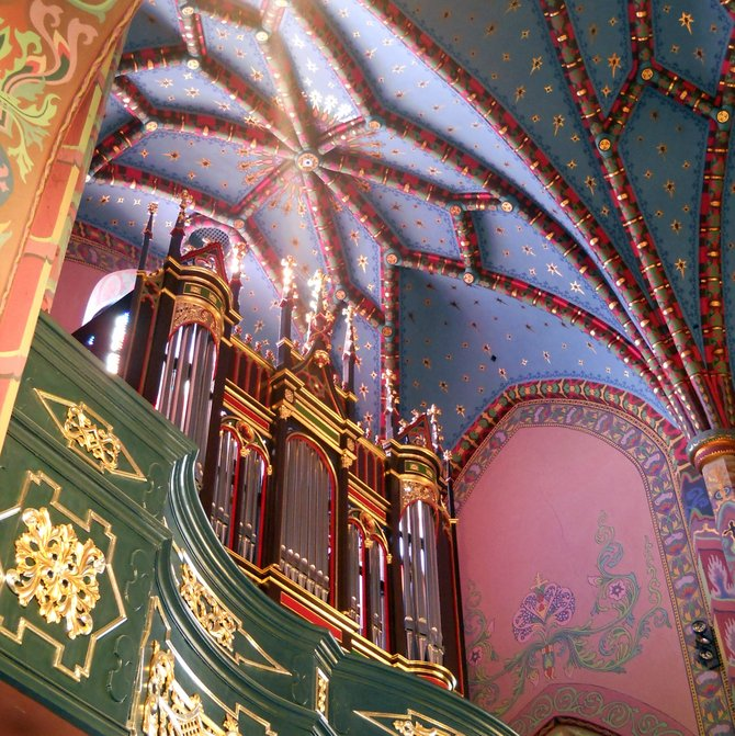 Organ Gallery / Choir Loft (St. Adalbert Church in Poznan). This Gothic three-nave church, with a sacristy and wooden belfry, is characterized by its Art Nouveau murals (interior with secessionist polychromy), unique wonderful vaulted network, and Mannerist side altars dating from around 1630. The stylized high altar features a Late Gothic relief of the Assumption of the Blessed Virgin Mary (Wit Stwosz School). During World War II services of divine worship were conducted only in the two churches in Poznan: the St. Adalbert's and Our Lady of Sorrows Church (Saint Lazarus Housing Estate).