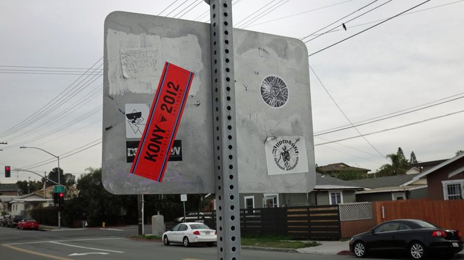 Street sign in North Park with KONY sticker.
